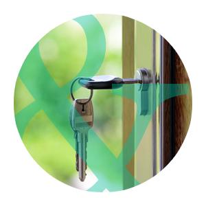 photo of keys in a door